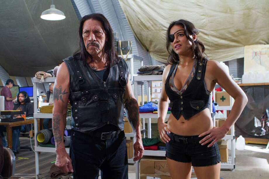 "This image released by Open Road Films shows Danny Trejo, left, and Michelle Rodriguez in a scene from ""Machete Kills."" (AP Photo/Open Road Films, Rico Torres) ORG XMIT: NYET213 Photo: Rico Torres / Open Road Films"