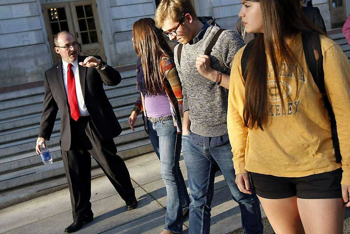 California GOP Assemblyman Tim Donnelly, left, speaks with students as they walk on campus following his speech in Wheeler Hall at the University of California in Berkeley, CA Wednesday, October 9, 2013.