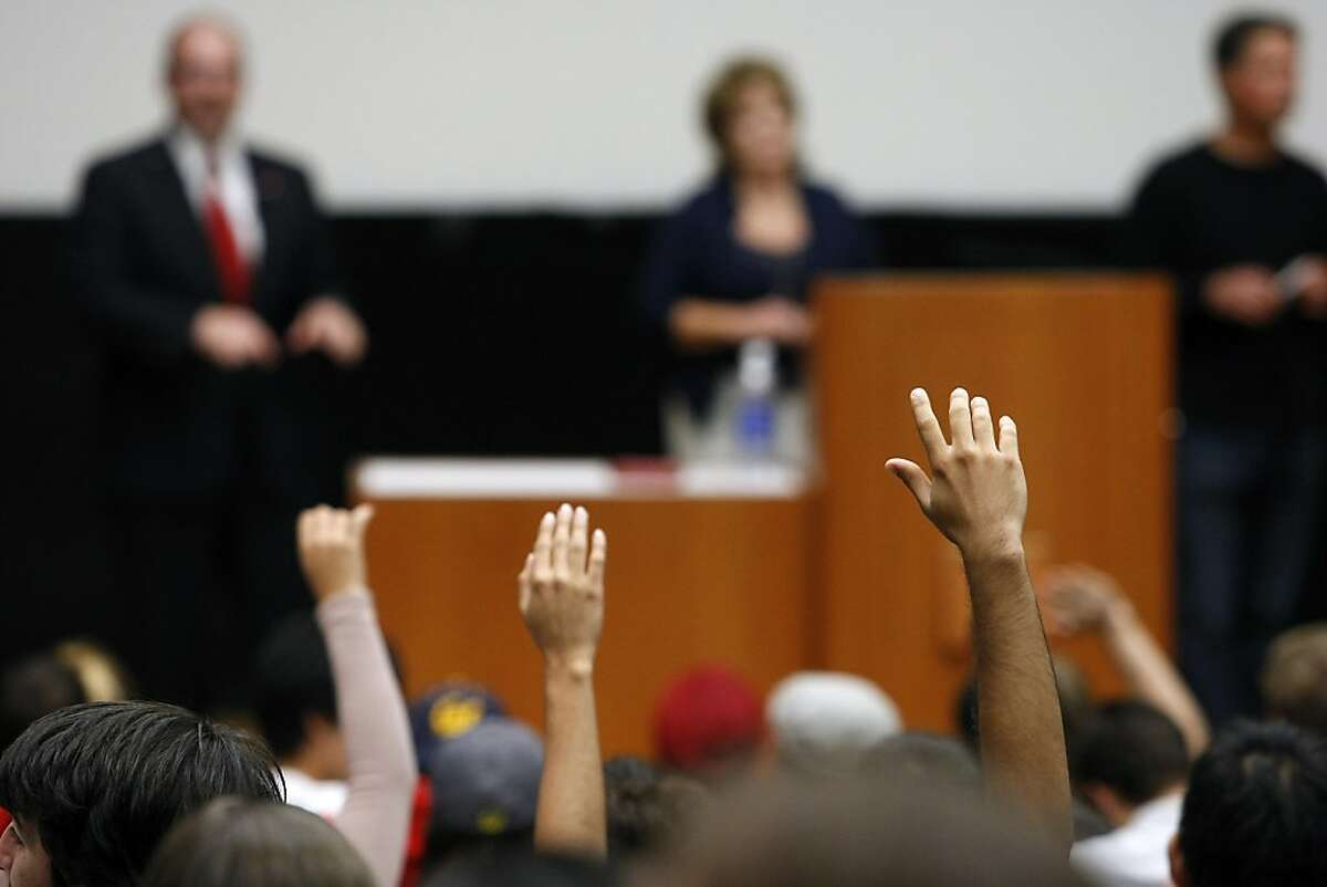 Students raise their hands to ask questions as California GOP Assemblyman Tim Donnelly speaks during professor Alan Ross's Political Science class held in Wheeler Hall on the University of California campus in Berkeley, CA Wednesday, October 9, 2013.