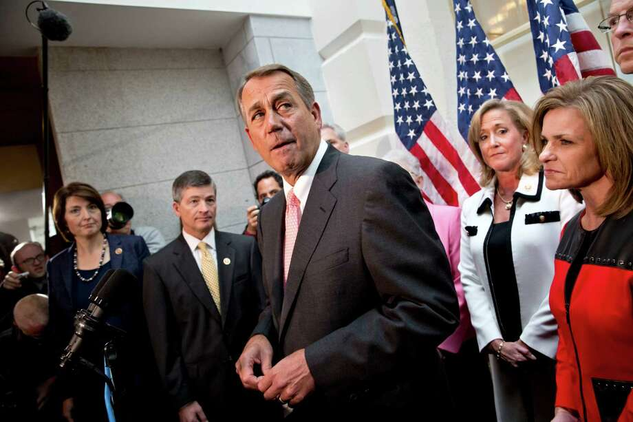 House Speaker John Boehner of Ohio, joined by fellow Republicans, speaks during a news conference on Capitol Hill in Washington, Thursday, Oct. 10, 2013, following a closed-door GOP meeting, to announce that House Republicans will advance legislation to temporarily extend the government's ability to borrow money to meet its financial obligations. From left are, Rep. Cathy McMorris Rodgers, R-Wash., Rep. Jeb Hensarling, R-Texas, Boehner, Rep. Ann Wagner, R-Mo., and Rep. Lynn Jenkins, R-Kansas. The federal government remains partially shut down for a 10th day and faces a first-ever default between Oct. 17 and the end of the month. (AP Photo/J. Scott Applewhite) Photo: J. Scott Applewhite, Associated Press / AP
