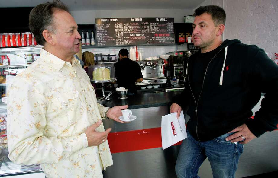 Giuseppe Bonaiuto, left, talks with Claudio Fidaleo, right, about the commercial machines available for Fidaleo's new restaurant at BonJo Coffee Bar in Stamford, Conn., on Thursday, October 10, 2013. Fidaleo is opening Capeesh on High Ridge Road and expects it to be open by November 15, 2013. Photo: Lindsay Perry / Stamford Advocate