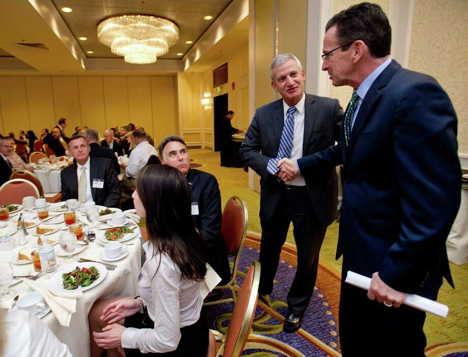 Gov. Dannel Malloy is greeted at the Stamford Chamber of Commerce's annual meeting at the Stamford Mariott hotel on Thursday, October 10, 2013. Photo: Lindsay Perry / Stamford Advocate