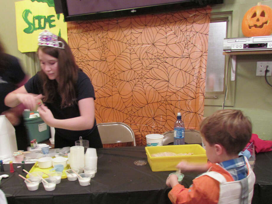 The Connecticut Audubon Societyís Enchanted Forest will be offered this year on Friday, Oct. 25. One of the activities last year was slime making as well as a guided flashlight tour of the forest. Photo: Contributed Photo / Fairfield Citizen