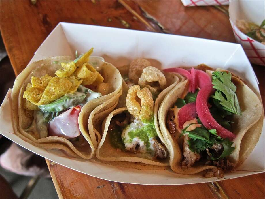 Taco Nuts tacos (l to r): avocado, tomato and mango with Thai herbs; carnitas with spiced lime aioli & cracklins; and Dr. Pepper-braised short rib with pickled onions. Photo: Alison Cook