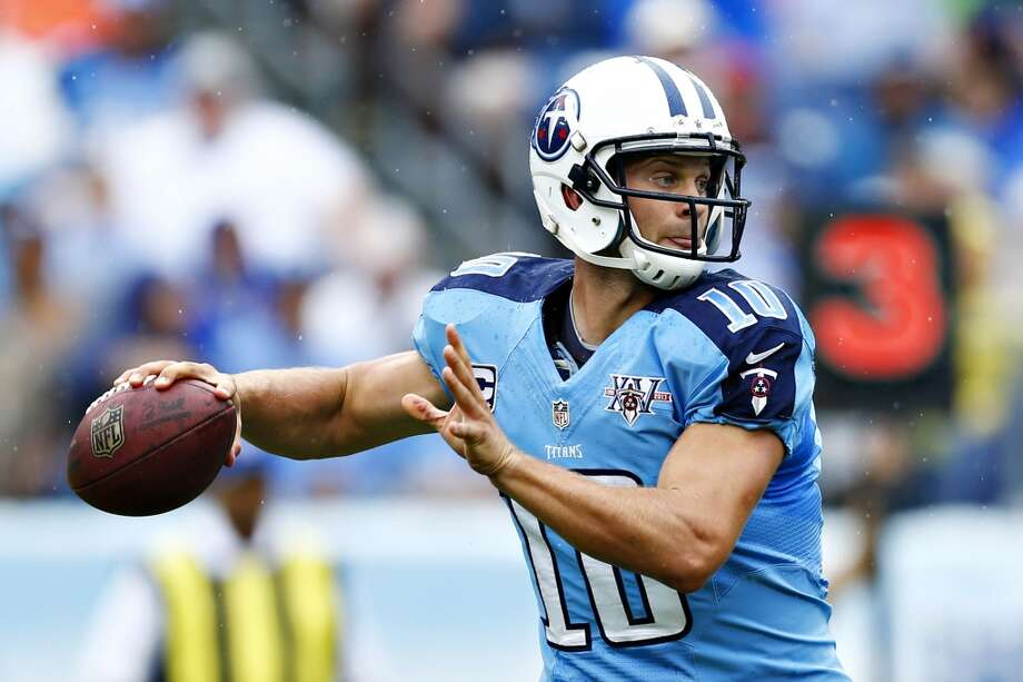 """Q: What are your thoughts on former Huskies and current Titans QB Jake Locker?PC:""""I'm glad you brought it up. He's really playing well. His accuracy on all kinds of throws -- whether it's down-the-field stuff, movement stuff, the stuff up top -- he's very sharp. He's had no interceptions in his first games playing. He has run well, and you can really see the growth. He's really commanding their offense and he looks great. He looks like a really top-flight quarterback off to a great start in the season."""" Photo: Wesley Hitt, Getty Images"""