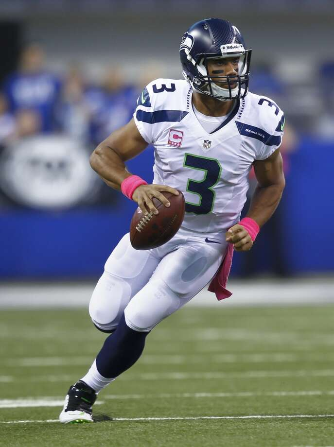 """Q: Will Russell Wilson keep using his legs if nothing's there through the air?PC:""""It's going to depend on how it goes. He understands. Yeah, so I'd trust him to understand, and when we think he took off too early or he didn't give a play a chance, then we say something about it. It's not happening that much. We've been very, very specific about that, in evaluating the times that he has taken off. He's taking advantage of opportunities that have been huge and it has been a significant aspect these last couple of games to move the ball.   """"But we're always watching that. Sure, we want to make sure that he is giving the plays a chance when he does get good protection. It's a challenge when it's been a little bit scattered up front and I think that he's handled it really well, and the coaches think that too. We've gone and looked specifically at that and see, 'Is he hanging in the pocket when he gets his chances, and giving the routes and receivers an opportunity?' And I've think he's done that."""" Photo: Michael Hickey, Getty Images"""