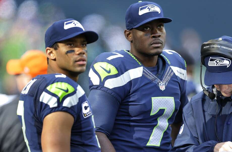 """Q: How involved is Wilson with the management of the offensive scheme?PC:""""Yeah I think it's an ongoing process in that regard. From Coach Darrell Bevell (offensive coordinator) to Coach Carl Smith (quarterbacks) and even Coach Tom Cable (offensive line) in the run game and all, we're all working with it to manage him. He can handle everything we tell him, we just have to make sure that our information is really on point.   """"It doesn't mean he doesn't need work at things. He needs to develop his timing and his expectations of how things are going to go and all. With the quarterback, you're always working. ... I don't really think that stops. That's how you work together with him. The relationships are so important that you can communicate well, and he can handle the stuff that we're telling him, and we pick and choose the right stuff to share with him to help him out. That's a real ongoing communication and dialogue."""" Photo: Ted S. Warren, Associated Press"""