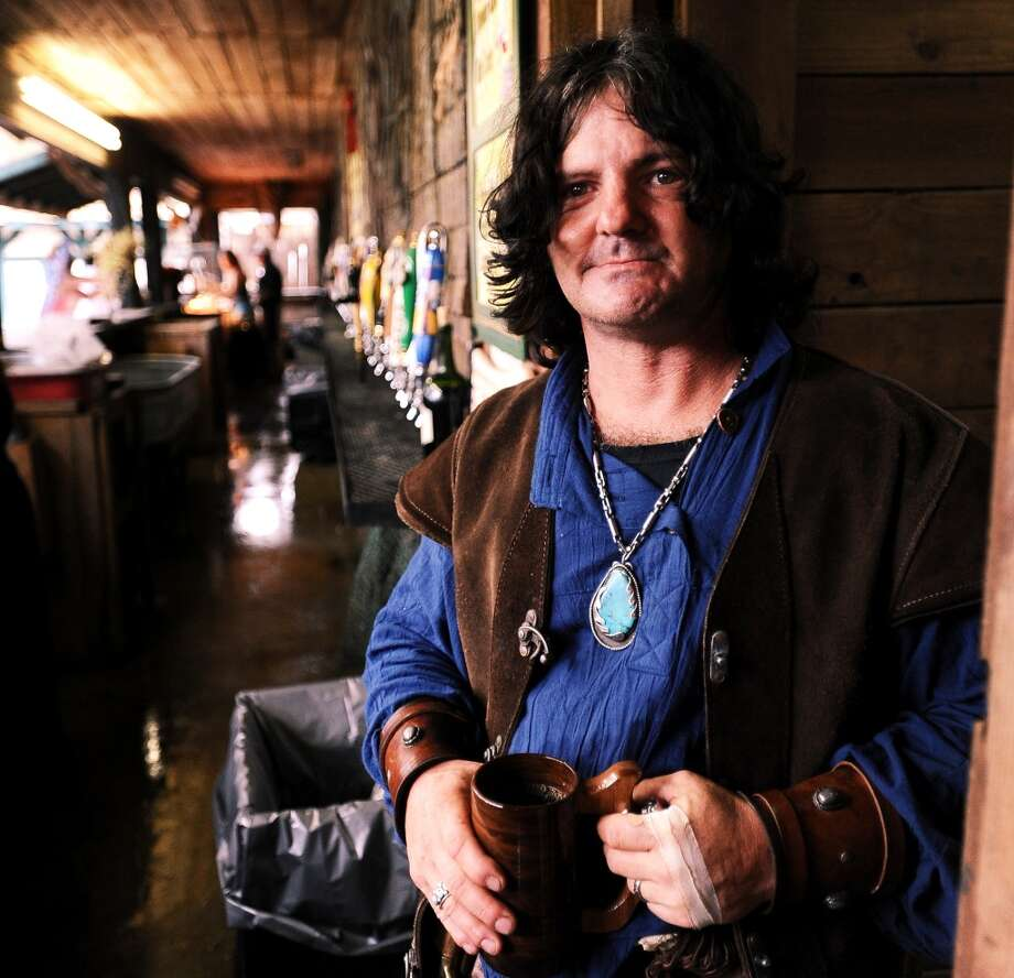 Jason Presley from Magnolia, TX works the bar at the Sea Devil Tavern at the Texas Renaissance Festival in Plantersville, TX on Sunday, October 14, 2012. Photo taken: Randy Edwards/The Enterprise