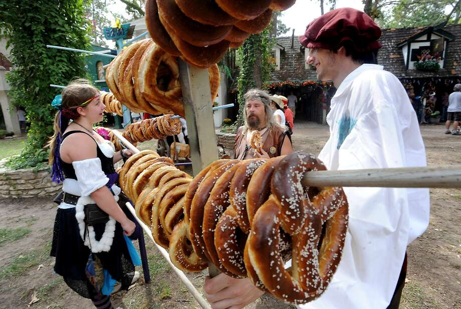 "Mark ""Knodd"" Birdwell (center) buys a pretzel from Hayley Hanes and Spenser Umbricht at the Texas Renaissance Festival, Saturday, October 8, 2011. Tammy McKinley/The Enterprise Photo: Beaumont Enterprise"
