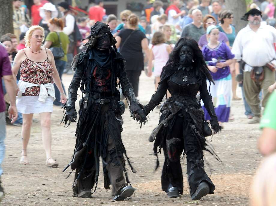 Thousand of visitors, some in elaborate costumes, attend opening day at the Texas Renaissance Festival, Saturday, October 8, 2011. Tammy McKinley/The Enterprise Photo: Beaumont Enterprise