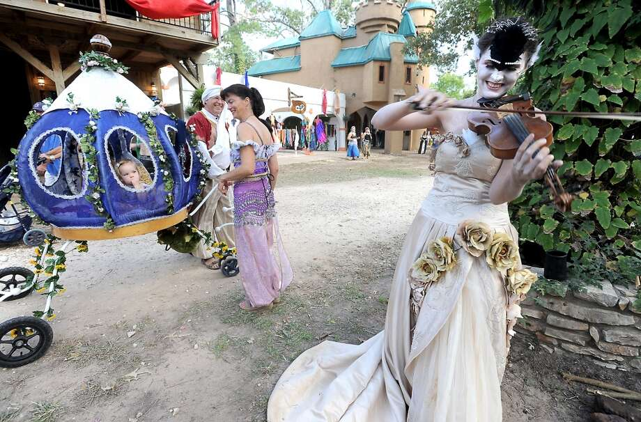 "Gina ""Finnoula"" Williamson plays the violin at the Texas Renaissance Festival, Saturday, October 8, 2011. Tammy McKinley/The Enterprise Photo: Beaumont Enterprise"