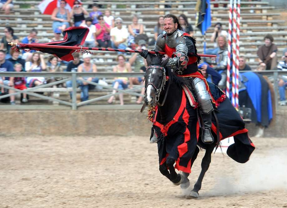 The Champion of Spain enters the jousting arena at the Texas Renaissance Festival, Saturday, October 8, 2011. Tammy McKinley/The Enterprise Photo: Beaumont Enterprise