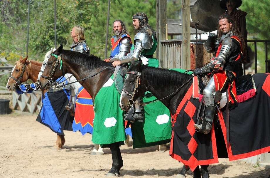Knights prepare for battle in the jousting arena at the Texas Renaissance Festival, Saturday, October 8, 2011. Tammy McKinley/The Enterprise Photo: Beaumont Enterprise