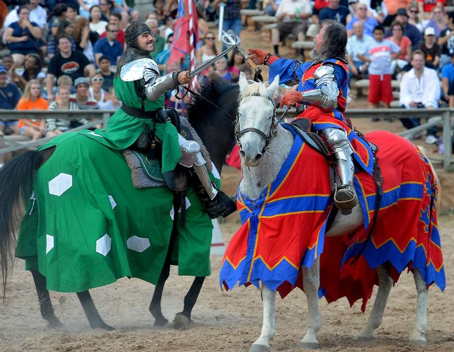 Knights battle in sword combat on horseback in the jousting arena at the Texas Renaissance Festival, Saturday, October 8, 2011. Tammy McKinley/The Enterprise Photo: Beaumont Enterprise