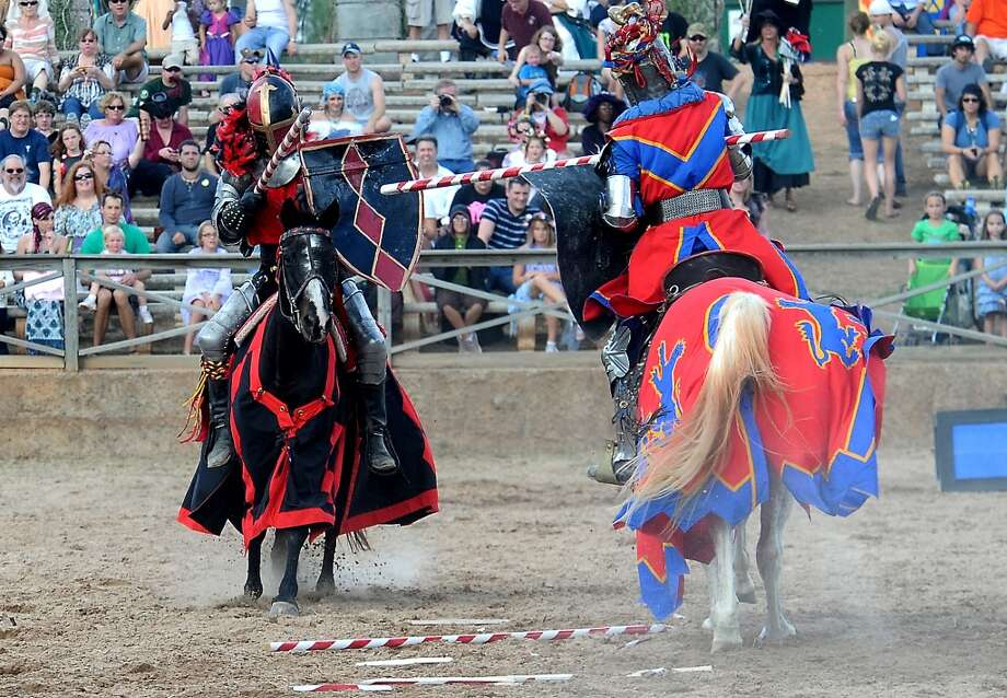 Two knighs joust in the arena at the Texas Renaissance Festival, Saturday, October 8, 2011. Tammy McKinley/The Enterprise Photo: Beaumont Enterprise