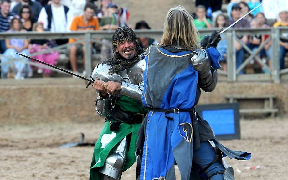 Knights battle in sword combat in the jousting arena at the Texas Renaissance Festival, Saturday, October 8, 2011. Tammy McKinley/The Enterprise Photo: Beaumont Enterprise