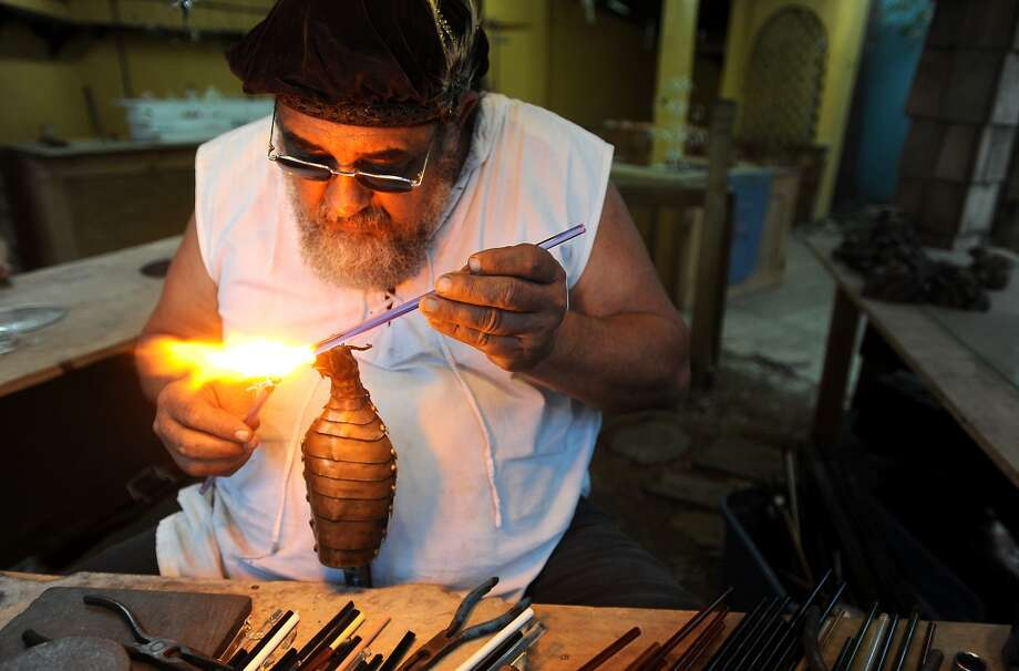 Alan Gardner demonstrates creating glass trinkets at Creations in Glass at the Texas Renaissance Festival, Saturday, October 8, 2011. Tammy McKinley/The Enterprise Photo: Beaumont Enterprise