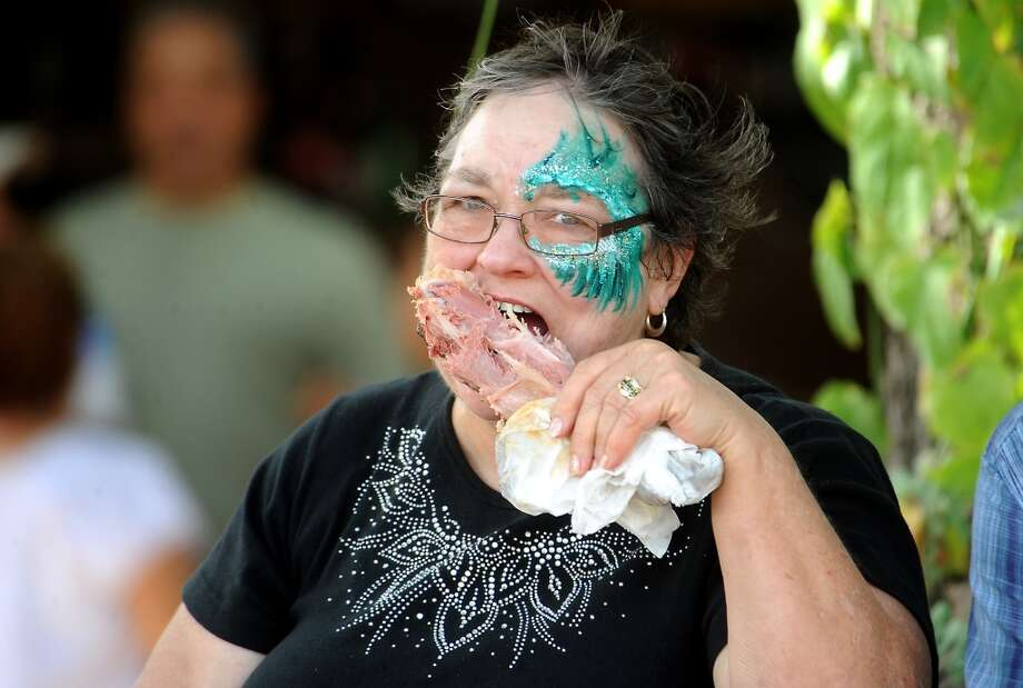 Susan Maxey eats a turkey leg while visiting from Missouri at the Texas Renaissance Festival, Saturday, October 8, 2011. Tammy McKinley/The Enterprise Photo: Beaumont Enterprise