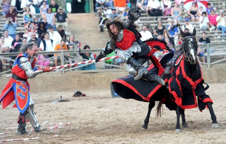 Knights engage in battle during the jousting performance at the Texas Renaissance Festival, Saturday, October 8, 2011. Tammy McKinley/The Enterprise Photo: Beaumont Enterprise