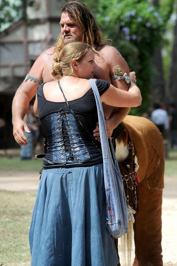 "Larry ""Chirons The Centaur"" Collins gets a hug from his Lady, Melissa Orchid during the Texas Renaissance Festival, Saturday, October 8, 2011. Tammy McKinley/The Enterprise Photo: Beaumont Enterprise"