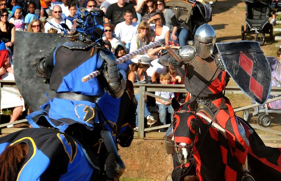 Knights joust in during a competition at the Texas Renaissance Festival on Saturday. The festival offers four competitions each day in The Arena. Guiseppe Barranco/The Enterprise Photo: Guiseppe Barranco/The Enterprise
