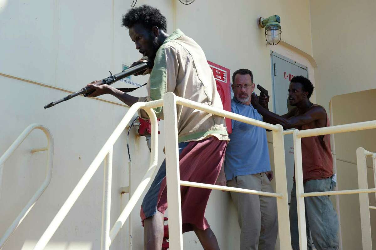 """This film image released by Sony - Columbia Pictures shows, from left, Mahat Ali, Tom Hanks and Faysal Ahmed in a scene from """"Captain Phillips."""" (AP Photo/Sony - Columbia Pictures)"""