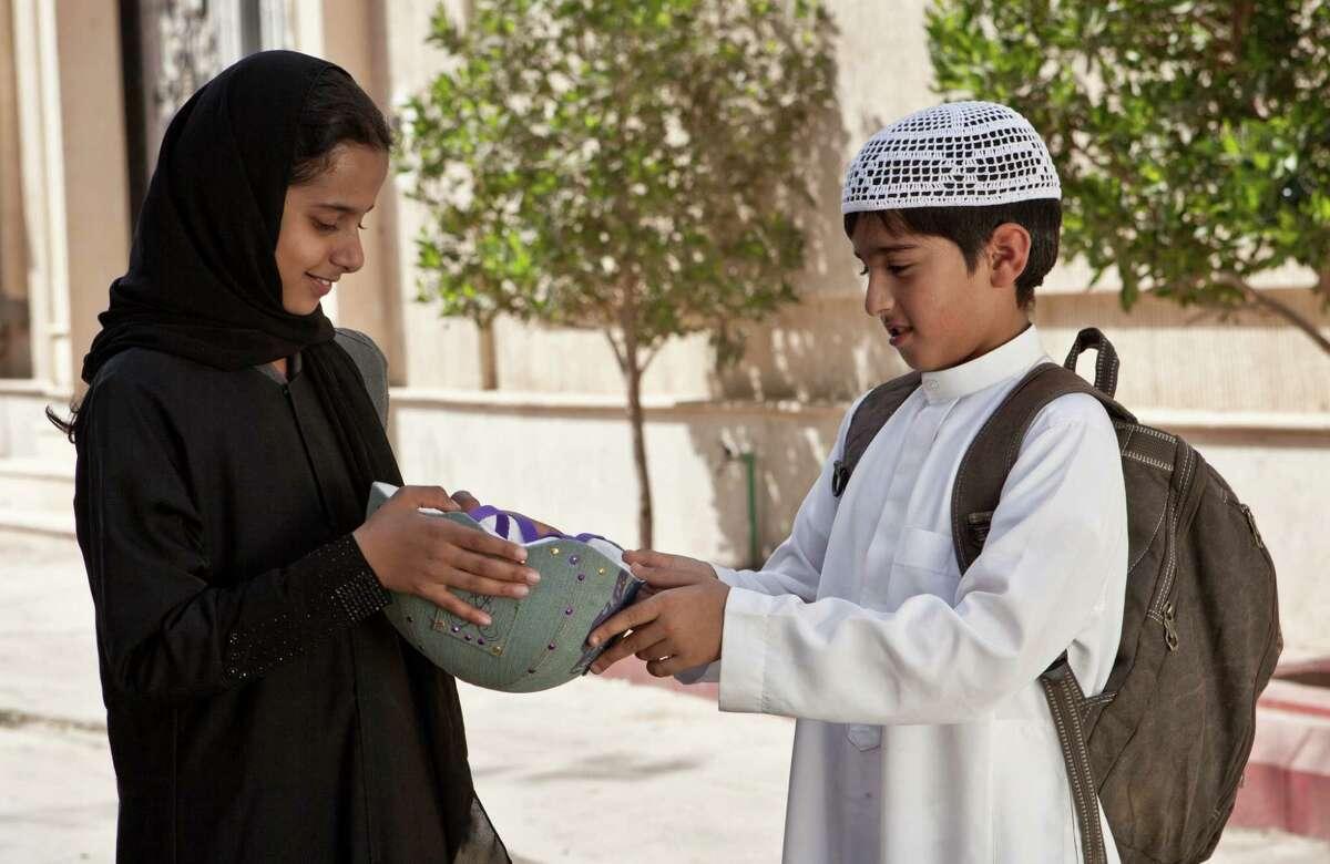 Waad Mohammed, left, stars as the titular Wadjda, and Abdullrahman Al Gohani is her friend Abdullah in