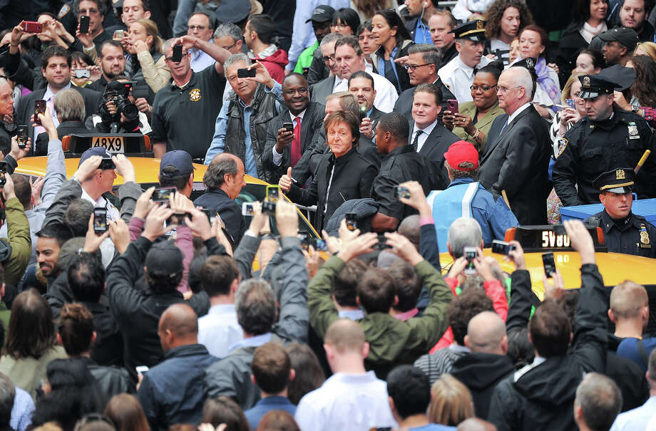Sir Paul McCartney arrives with his band to give a surprise pop up concert in Times Square on Thursday, Oct. 10, 2013 in New York. Photo: Evan Agostini, Evan Agostini/Invision/AP / Invision