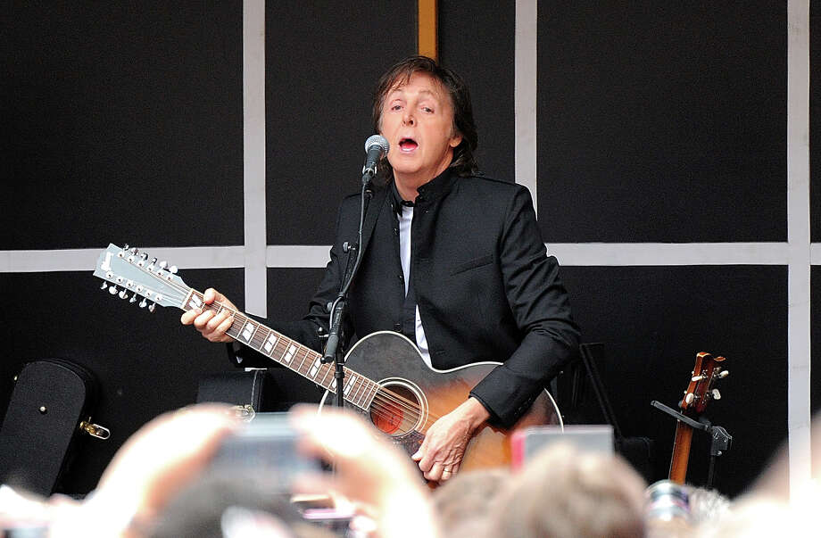 Sir Paul McCartney and his band give a surprise pop up concert in Times Square on Thursday, Oct. 10, 2013 in New York. Photo: Evan Agostini, Evan Agostini/Invision/AP / Invision2013