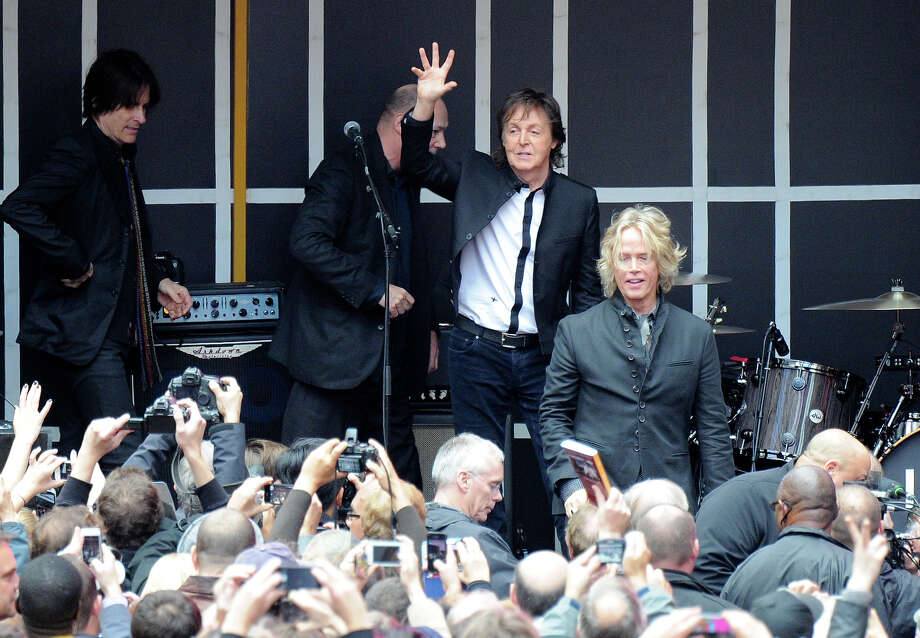 Sir Paul McCartney and his band give a surprise pop up concert in Times Square on Thursday, Oct. 10, 2013 in New York. Photo: Evan Agostini, Evan Agostini/Invision/AP / Invision