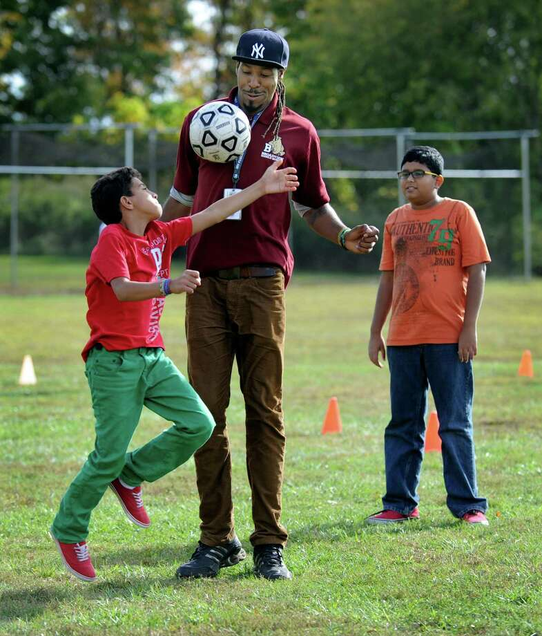 Travon Little, safety advocate, plays soccer with Joao DaSilva, left, and Rajin Ahmed, both 12, in a Unified Sports program at Broadview Middle School Wednesday, Oct. 9, 2013. Photo: Carol Kaliff / The News-Times