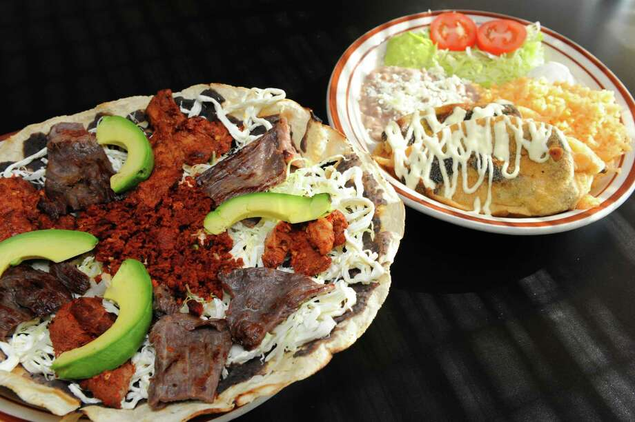 Tlayuda, hard shell Mexican pizza, left, and chiles rellenos at La Mexicana restaurant and grocery store on Tuesday Oct. 1, 2013 in Schenectady, N.Y. (Michael P. Farrell/Times Union) Photo: Michael P. Farrell / 00024060A
