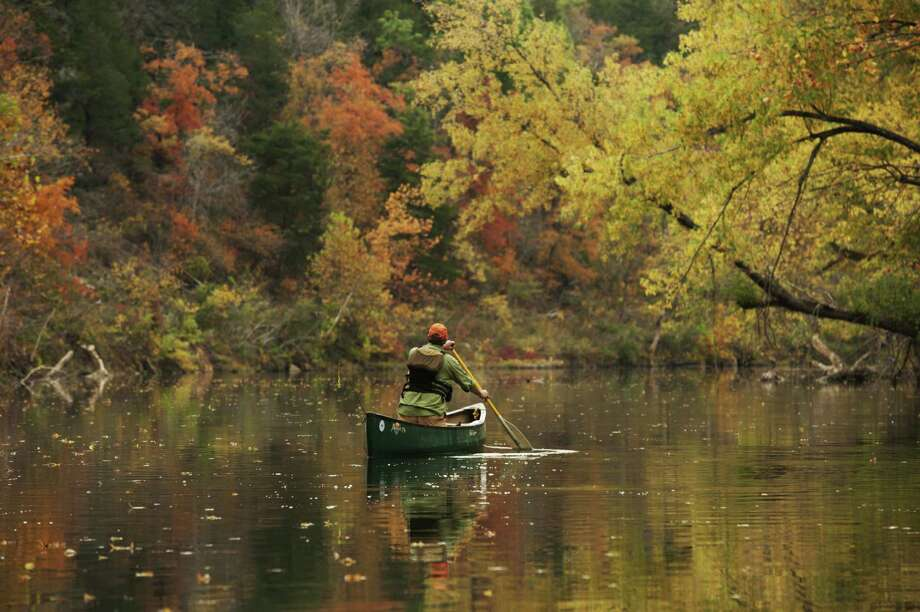 A canoe trip down Kings River in Arkansas offers a close-up view of the trees turning red and gold for fall. Photo: Courtesy Photo