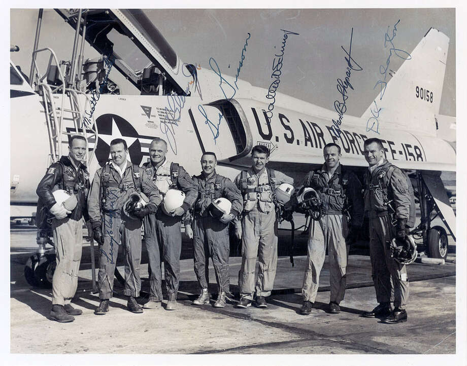 Vintage glossy 10 x 8.5 NASA photo of the Mercury astronauts posing in their flight suits in front of an F-106, signed in black ink. Scott Carpenter, H. Glenn, Jr.,Walter M. Schirra,Leroy S. Cooper, Jr., and Alan B. Shepard, Jr. Photo also bears autopen signatures of Gus Grissom and Deke Slayton. Photo: Contributed Photo