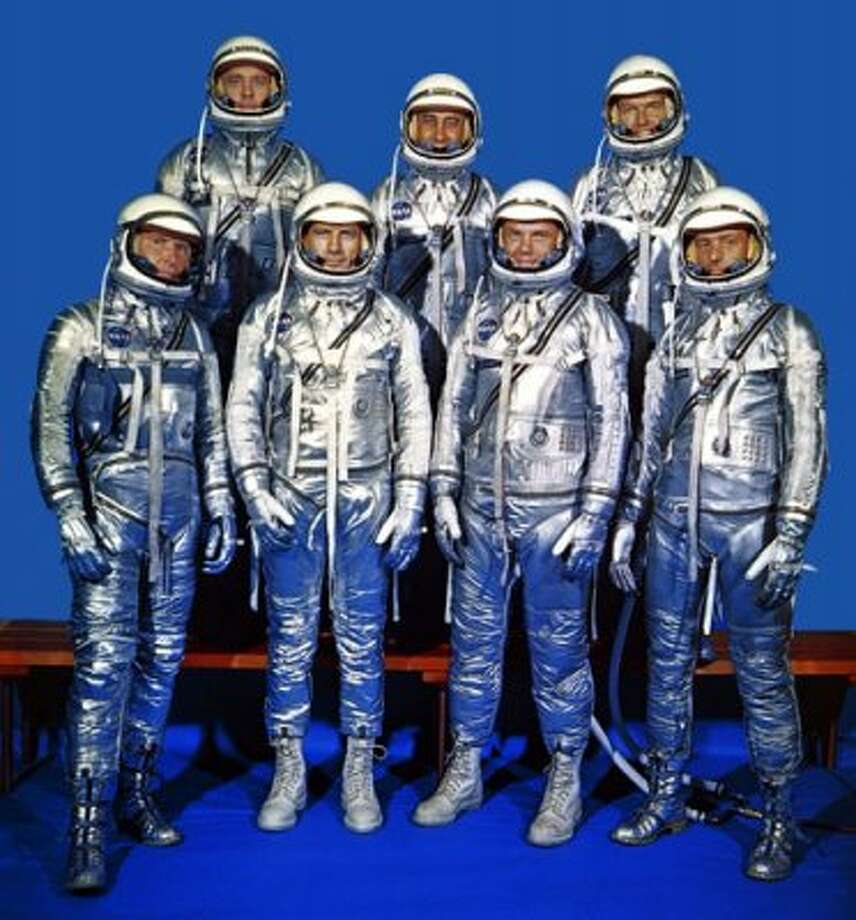 On April 9, 1959, NASA introduced the country to its first astronauts. They were, front row, left to right: Walter H. Schirra, Jr., Donald K. Slayton, John H. Glenn, Jr., and M. Scott Carpenter. Back row: Alan B. Shepard, Jr., Virgil I. 'Gus' Grissom, and L. Gordon Cooper.  (KRT)