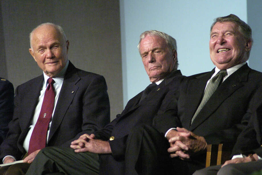 Former astronauts (L to R) John Glenn, Scott Carpenter and Wally Shirra  listen to a tribute of their former Project Mercury teammate, Gordon Cooper, at a memorial service at the Johnson Space Center.  (Steve Ueckert / Chronicle) Photo: Steve Ueckert, Houston Chronicle / Houston Chronicle