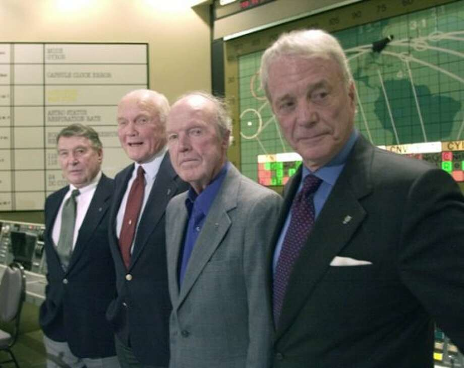 Mercury astronauts Wally Schirra, from left, John Glenn, Gordon Cooper and Scott Carpenter, are shown in the original Mercury control room at Kennedy Space Center in Cape Canaveral on Feb. 24, 2002. The former astronauts were celebrating the 40th anniversary of John Glenn's first orbital flight. Glenn, 80, who was the first American to orbit the Earth on Feb. 20, 1962, also became the oldest person ever to fly in space in 1998. (AP Photo/Peter Cosgrove).     HOUCHRON CAPTION (02/25/2002):  The four surviving Mercury astronauts, from left, Wally Schirra, 78; John Glenn, 80; Gordon Cooper, 74; and Scott Carpenter, 76, are shown in the original Mercury control room at Kennedy Space Center in Cape Canaveral, Fla., Sunday. The former astronauts were celebrating the 40th anniversary of John Glenn's first orbital flight, Feb. 20, 1962. (AP)
