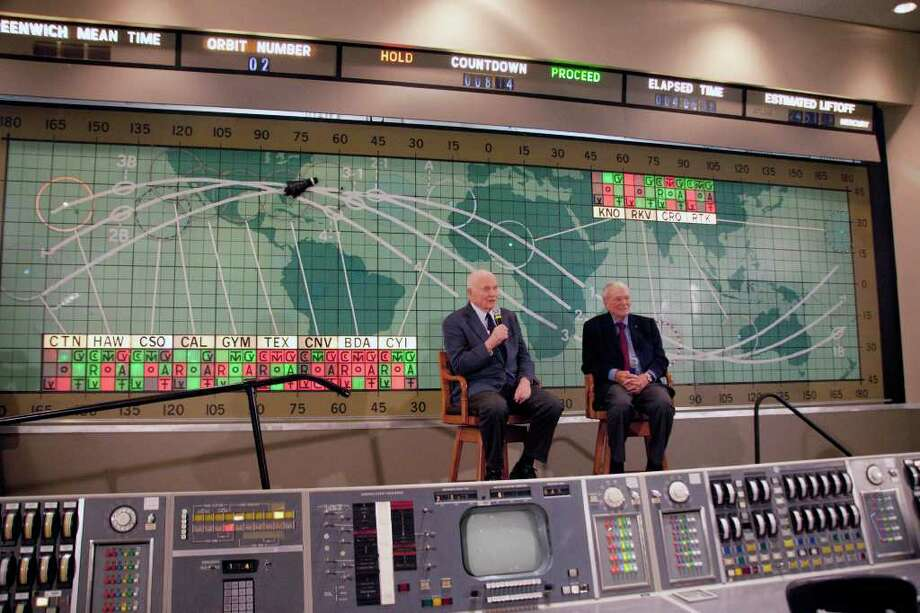 Former Sen. John Glenn, left, and Scott Carpenter, right, speak at the Kennedy Space Center, Friday, Feb. 17, 2012 in Cape Canaveral, Fla. John Glenn fever has taken hold in the U.S. once again. Three days before the 50th anniversary of his historic flight, the first American to orbit the Earth addressed employees at Kennedy Space Center. (AP Photo/Michael Brown) Photo: Michael Brown / FR170587