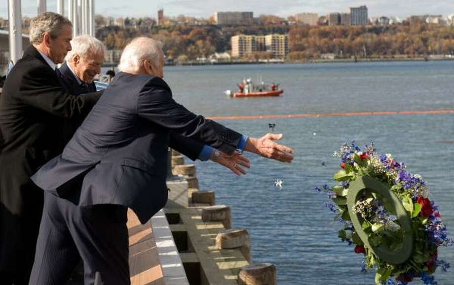 President Bush, with ex-astronauts Buzz Aldrin and Scott Carpenter, releases a wreath at the USS Intrepid Sea, Air & Space Museum in New York. Photo: SAUL LOEB, AFP/GETTY IMAGES