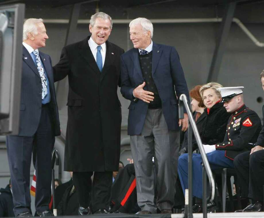 President Bush walks with former astronauts Edwin 'Buzz' Aldrin, left, and Scott Carpenter, during the rededication ceremony of the Intrepid Sea, Air and Space Museum in New York, Tuesday, Nov. 11, 2008. Sen. Hillary Rodham Clinton, D-N.Y. sits second from right. Photo: Gerald Herbert, AP / AP