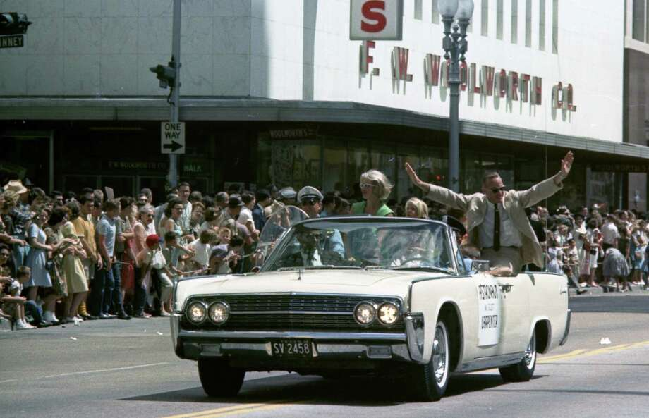 07/04/1962 - Welcome Manned Spacecraft Center parade organized by the Houston Chamber of Commerce. The parade welcomed astronauts, their families and MSC workers and their families - many of whom are newcomers to Houston. Astronaut Scott Carpenter waves to the crowd. staff / Houston Chronicle Photo: Houston Chronicle, © Houston Chronicle / Houston Chronicle