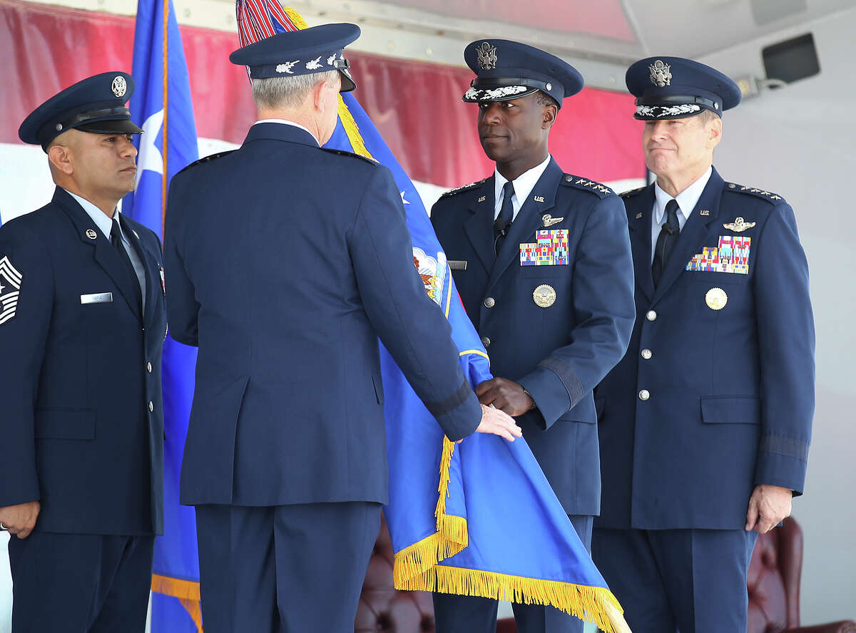 Gen. Edward A. Rice, Jr. (center) relinquishes the command flag to Gen. Mark A. Welsh, Chief of Staff of the U.S. Air Force, as Gen. Robin Rand awaits to accept the flag during the Air Education and Training Command change of command ceremony and Rice's retirement ceremony at Randolph Air Force Base on Thursday, Oct. 10, 2013.