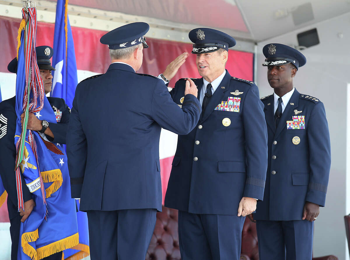 Gen. Robin Rand (center) salutes Gen. Mark A. Welsh, Chief of Staff of the U.S. Air Force, as Gen. Edward A. Rice, Jr. looks on during the Air Education and Training Command change of command ceremony and Rice's retirement ceremony at Randolph Air Force Base on Thursday, Oct. 10, 2013.