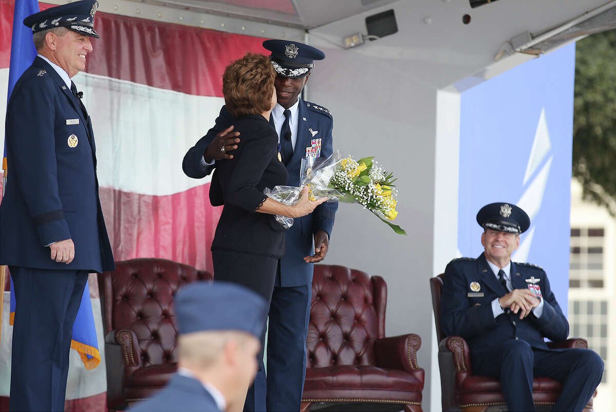 Gen. Edward A. Rice, Jr. (center) receives a kiss from his wife, Teresa, during Rice's retirement ceremony at Randolph Air Force Base on Thursday, Oct. 10, 2013. Rice served three years as head of the Air Education and Training Command.