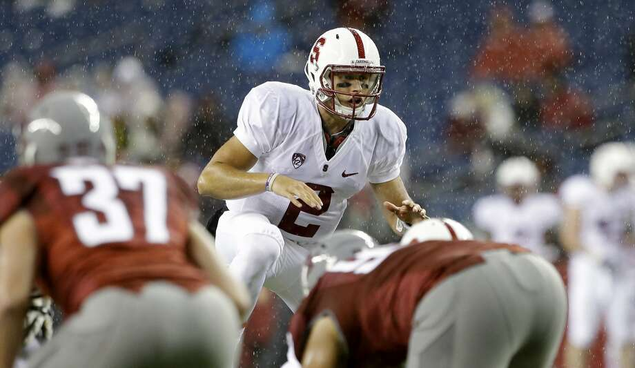 Stanford quarterback Dallas Lloyd in action against Washington State in the second half of an NCAA college football game Saturday, Sept. 28, 2013, in Seattle. Stanford won 55-17. (AP Photo/Elaine Thompson) Photo: Elaine Thompson, Associated Press