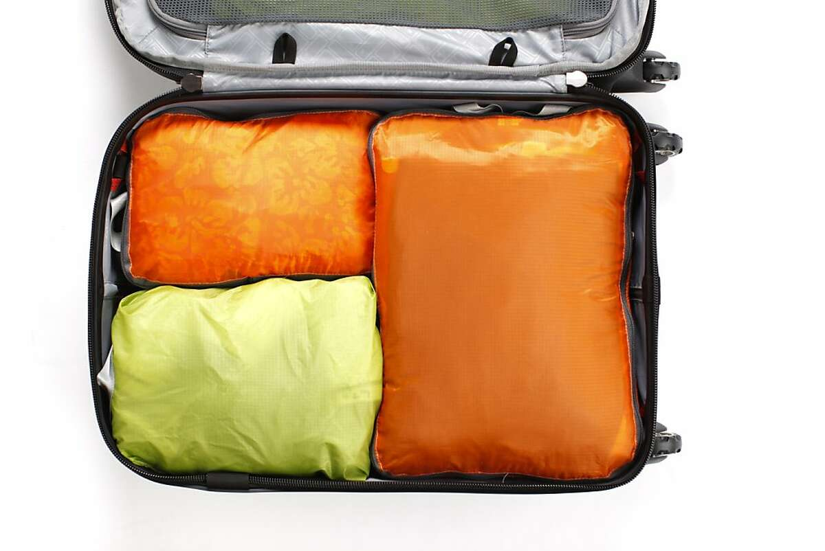 Using packing cubes, seen on Thursday, Oct. 10, 2013 in San Francisco, Calif., is one method for packing a carry-on suitcase.