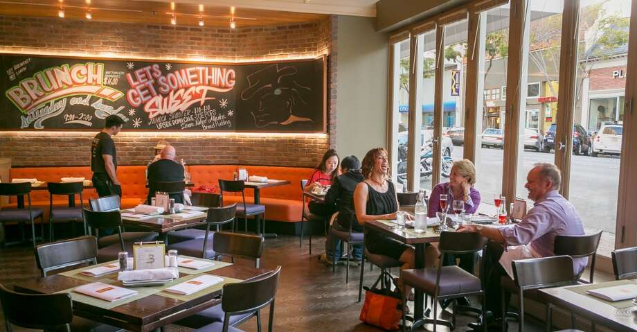 People enjoy dinner at Three in San Mateo. Photo: John Storey, Special To The Chronicle
