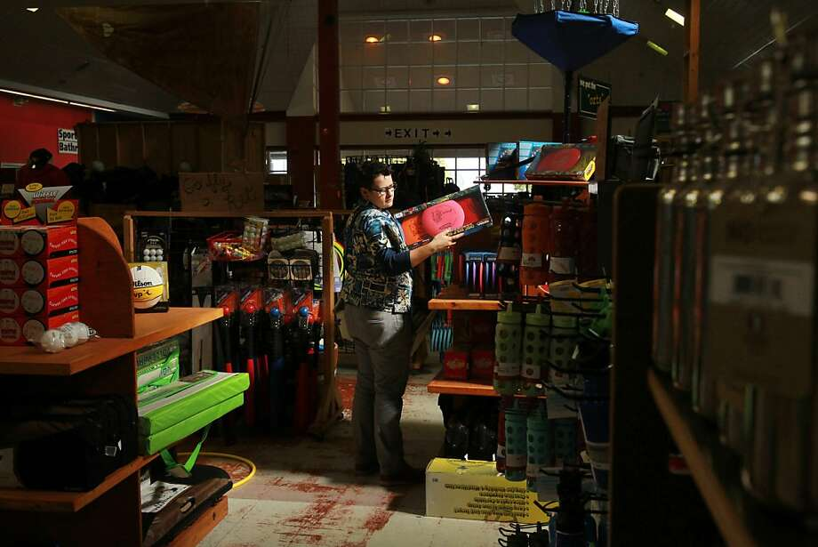 Jessica Killy checks out merchandise at the Sports Basement, whose doors are open during the shutdown because the Presidio is financially self-sufficient and receives no government funds. Photo: Leah Millis, The Chronicle