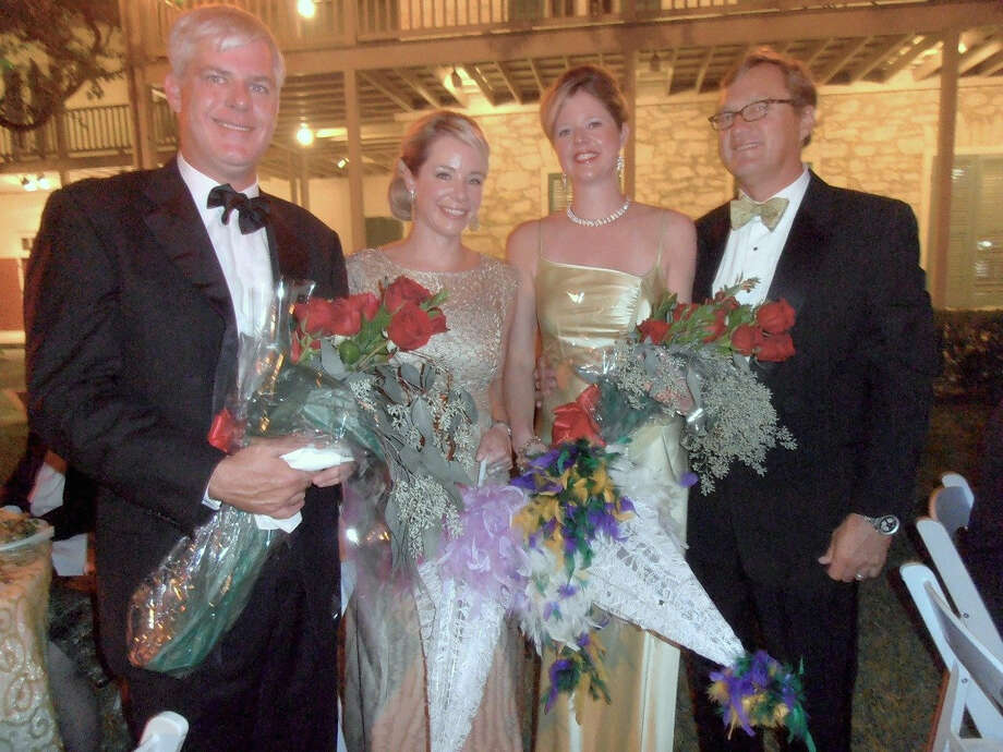 At the Southwest School of Art's Gala in the Garden, Timo and Ashley Hixon (from left) and Whitney and Joe Miller received roses as thanks for serving as co-chairs. Photo: Nancy Cook-Monroe / For The Express-News