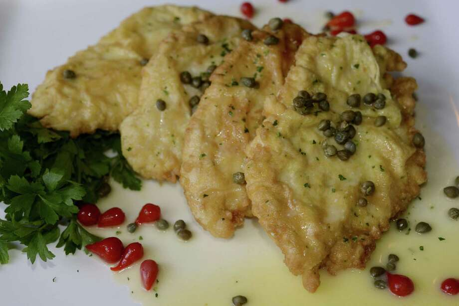 Executive chef Clark McDaniel's chicken piccata is coated with a minced garlic and Parmesan cheese batter. Photo: Courtesy Photo